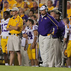 Oct 10, 2009; Baton Rouge, LA, USA; LSU Tigers head coach Les Miles (center) watches his team during a game against the Florida Gators at Tiger Stadium. Florida defeated LSU 13-3. Mandatory Credit: Derick E. Hingle-US PRESSWIRE