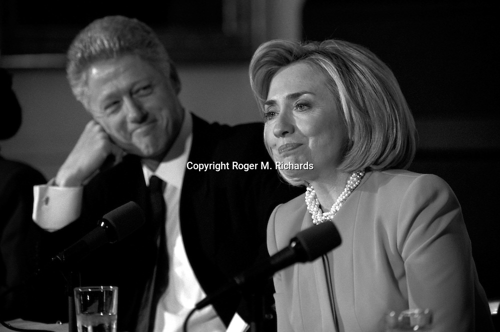 President Bill Clinton looks at his wife, Hillary Rodham Clinton, after she spoke at a White House conference on child care, Washington, DC, October 23, 1997.  (Photo by Roger M. Richards)