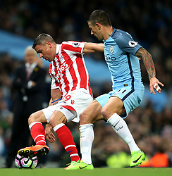 Jonathan Walters of Stoke City takes on Aleksandar Kolarov of Manchester City - Mandatory by-line: Matt McNulty/JMP - 08/03/2017 - FOOTBALL - Etihad Stadium - Manchester, England - Manchester City v Stoke City - Premier League