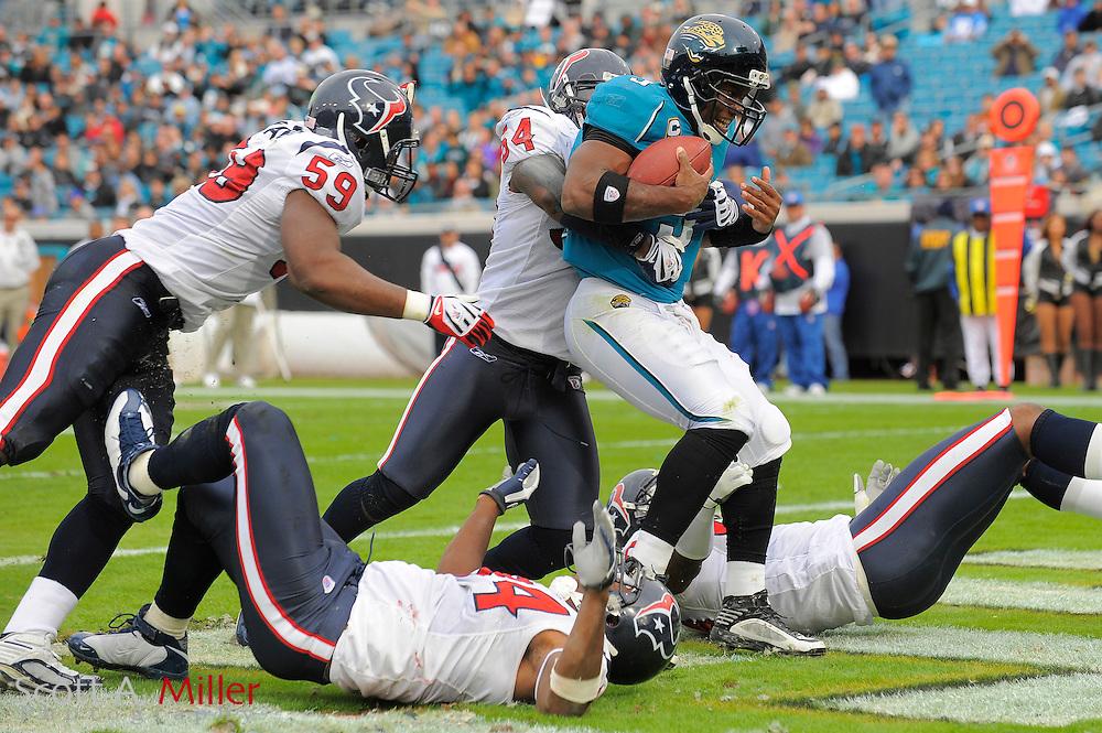 Dec. 6, 2009; Jacksonville, FL, USA; Jacksonville Jaguars quarterback David Garrard (9) is sacked by Houston Texans linebacker Zac Diles (54), defensive end Antonio Smith (94), linebacker DeMeco Ryans (59) and defensive end Tim Jamison (96) for a saftey at Jacksonville Municipal Stadium. ©2009 Scott A. Miller