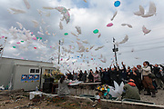 People release ballon doves with messages to victims of the 2011 Tsunami in Hiyoriyama Park in Natori, near Sendai, Miyagi, Japan. Friday March 11th 2016. 2016 marks the fifth anniversary of the Great East Japan earthquake. This magnitude 9 quake caused a tsunami that flattened large parts of the Tohoku coast killing around 18,000 people and caused a nuclear disaster at Fukushima Daichi Power Station.