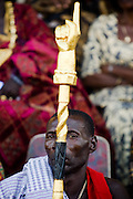 A man holds a golden staff shaped as a hand with a pointed index finger as he sits among traditional chiefs during the annual Oguaa Fetu Afahye Festival in Cape Coast, Ghana on Saturday September 6, 2008.