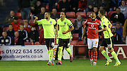 Brighton central midfielder, Jake Forster-Caskey celebrates after scoring from the penalty spot during the Capital One Cup match between Walsall and Brighton and Hove Albion at the Banks's Stadium, Walsall, England on 25 August 2015.