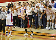 Linn-Mar Lion's Kristen Eiles (23) looks to inbound the ball as Washington Warrior's Aleena Hobbs (10) defends and the Warrior's student section yells during their Regional Semi-Final game at Washington High School in Cedar Rapids on Saturday, February 16 2013.