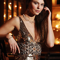 Model Lauren Tempany shows off a £100,000 Christmas Day Gift from Edinburgh Jeweller Hamilton & Inches.  She is wearing a £61,750 18ct Gold and pave set Diamond Poison Ivy twistvine collar designed by celelbrity designer Stephen Webster, £1379 Deco gold sequinned gown by Jenny Packham and Diamond earrings and bracelets.
