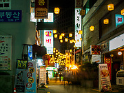 """13 JUNE 2018 - SEOUL, SOUTH KOREA: Korean barbecue and seafood restaurants on Sejong-daero 14-gil in central Seoul. The street is close to several office complexes in downtown Seoul and the restaurants and bars are popular with South Korean """"salary men.""""       PHOTO BY JACK KURTZ"""