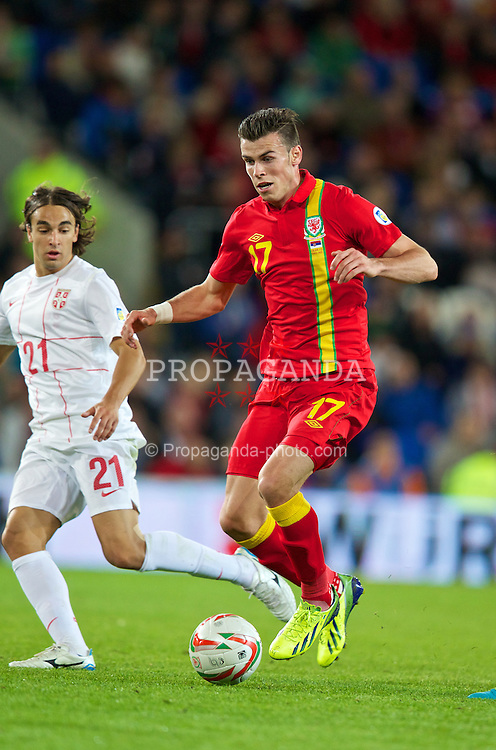 CARDIFF, WALES - Tuesday, September 10, 2013: Wales' Gareth Bale in action against Serbia during the 2014 FIFA World Cup Brazil Qualifying Group A match at the Cardiff CIty Stadium. (Pic by David Rawcliffe/Propaganda)