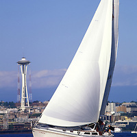 USA, Washington, Seattle, Yacht sails past Space Needle on summer afternoon in Elliot Bay