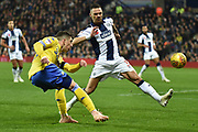Leeds United midfielder Pablo Hernandez (19) gets away a cross under pressure from West Bromwich Albion defender Kieran Gibbs (3) during the EFL Sky Bet Championship match between West Bromwich Albion and Leeds United at The Hawthorns, West Bromwich, England on 10 November 2018.