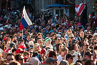A crowd of people cheer for the Sam Roberts Band in Village Square during the 2010 Olympic Winter Games in Whistler, BC