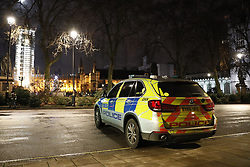 © Licensed to London News Pictures. 31/12/2017. London, UK. An police armed response vehicle sits in Parliament Square  in the build up to New Year's Eve fireworks at midnight. Photo credit: Peter Macdiarmid/LNP
