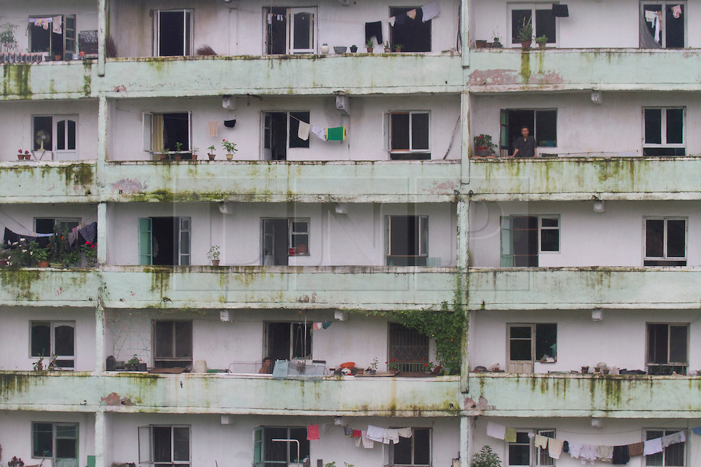© Licensed to London News Pictures. 12/08/2011. Kaesong, North Korea. A A view of an apartment building in Kaesong. The city is just 43km from the Southern capital of Seoul but still has poor infrastructure and suffers rolling blackouts. Photo credit : James Gourley/LNP/