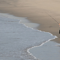 A man fishes from the Santa Monica shoreline on Thursday, December 2, 2010.