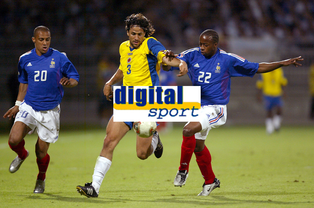 FOOTBALL - CONFEDERATIONS CUP 2003 - GROUP A - 030618 - FRANCE v COLUMBIA - MARIO YEPES (COL) / STEVE MARLET / SYDNEY GOVOU (FRA) - PHOTO GUY JEFFROY /DIGITALSPORT