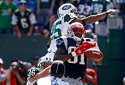 Sept 20, 2009; East Rutherford, NJ, USA;  New York Jets safety Kerry Rhodes (25) knocks the ball away from New England Patriots wide receiver Randy Moss (81) during the first half at Giants Stadium.
