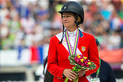 Beezie Madden and Cortes C win bronze individual jumping - Show Jumping Final Four - Alltech FEI World Equestrian Games™ 2014 - Normandy, France.<br />
