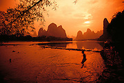 Children swim in the Li River near Xingping town outside Guilin, China.