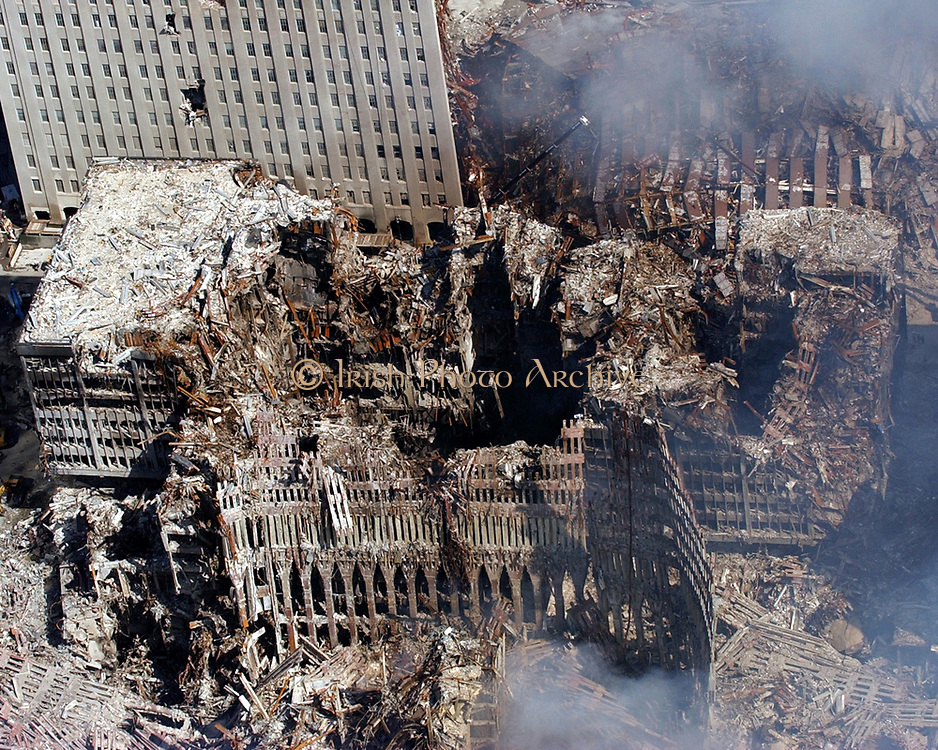 aerial view shows only a small portion of the crime scene where the World Trade Center collapsed following the Sept. 11 terrorist attack. Surrounding buildings were heavily damaged by the debris and massive force of the falling twin towers. Clean-up efforts are expected to continue for months. U.S. Navy photo