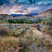Andrew Whiteford chases the sunset light back to the town of Jackson, Wyoming on his mountain bike.