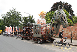 © Licensed to London News Pictures.30/07/2012. Rugby, UK. A 6m-high puppet of Lady Godiva arrived in Rugby today on the first stop of its journey from Coventry to London to celebrate the Olympics. The puppet, transported using a bike called the Cyclopedia, and powered by 100 cyclists will go to Northampton, Milton Keynes, Luton, Hatfield and Waltham Abbey before arriving at Waltham Forest on 5 August. Pictured, the puppet arrives in Rugby..Photo credit : Dave Warren/LNP
