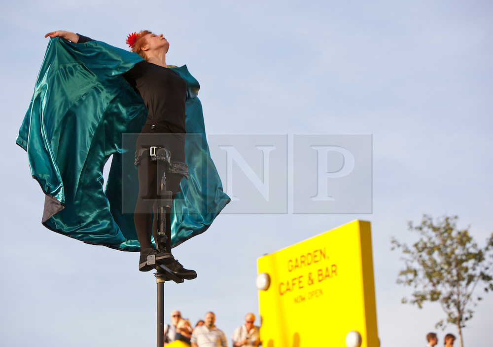 © Licensed to London News Pictures. 06/09/2012. Royal Festival Hall, London. Performers from the Graeae Theatre Company take part in a sway pole performance at one of many free live performances along the Southbank this evening...The Garden was commissioned as part of Unlimited, the London 2012 Cultural Olympiad programme, from an original idea by Greenwich+Docklands International Festival.  The show is based on the idea of a troupe of nomadic story-keepers (the Keeper of Dreams, Keeper of History, Keeper of Song and Keeper of Names), who share three stories of grace, growing up and imagination. For a brief moment in time, the Keepers open their garden-ritual - a ceremony of renewal, transformation, and harmony.  Original composed music plays as the artists take to four metre high sway poles to create new stories in the air.   Photo credit : Alison Baskerville/LNP