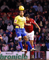 Photo: Dave Linney.<br />Walsall v Colchester United. Coca Cola League 1.<br />14/01/2006.<br />Colchester's Chris Iwelumo (L) beats Ian Roper to the ball.