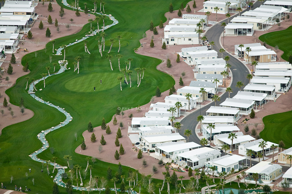 Manufactured housing, irrigated golf courses, and palm trees create the illusion of paradise at the Palm Creek Golf & RV Resort, which doubles as a retirement community and RV park. Using desert land is inexpensive in the short term but costly in the long term because of the energy and resources required to maintain the façade.