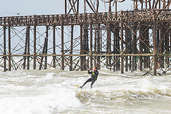 © Licensed to London News Pictures. 27/04/2019. Brighton, A member of the public takes advantage of the strong winds and powerful waves to kitesurfing in the sea in Brighton and Hove. While storm Hannah has been hitting Brighton and Hove throughout Friday night remnants can be felt on Saturday morning. Photo credit: Hugo Michiels/LNP