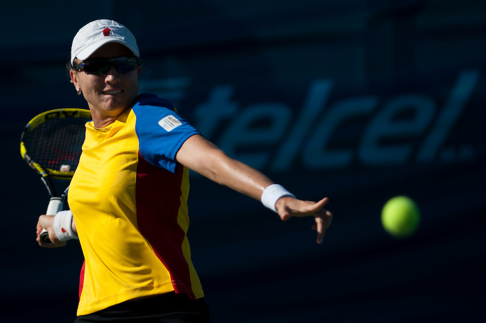 Oct. 17, 2011 - Guadalajara, Mexico - Catalina Castano of Colombia returns the ball to Ana Paula de la Pena of Mexico in the women's Tennis Singles match during the 2011 XVI Pan American Games at Tennis Complex Telcel in Ciudad Guadalajara, Mexico.©Benjamin B Morris
