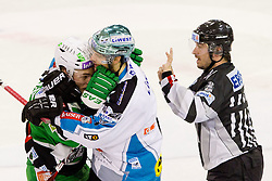 Domen Vedlin (HDD Tilia Olimpija, #7) roughing with Philipp Lukas (EHC Liwest Linz, #21) during ice-hockey match between HDD Tilia Olimpija and EHC Liwest Black Wings Linz at second match in Semifinal  of EBEL league, on March 8, 2012 at Hala Tivoli, Ljubljana, Slovenia. (Photo By Matic Klansek Velej / Sportida)