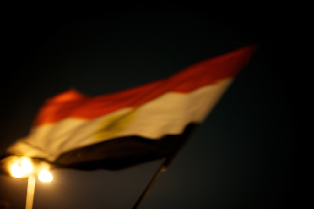 An egyptian national flag waving in Cairo's Tahrir Square.