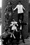 Members of Madness standing on each others shoulders.
