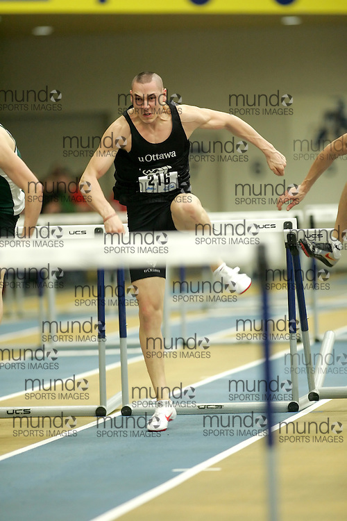 (Windsor, Ontario---11 March 2010) Patrick Arbour of University of Ottawa Gee-Gees competes in the  competes in the pentathlon 60m hurdles at the 2010 Canadian Interuniversity Sport Track and Field Championships at the St. Denis Center. Photograph copyright Sean Burges/Mundo Sport Images. www.mundosportimages.com
