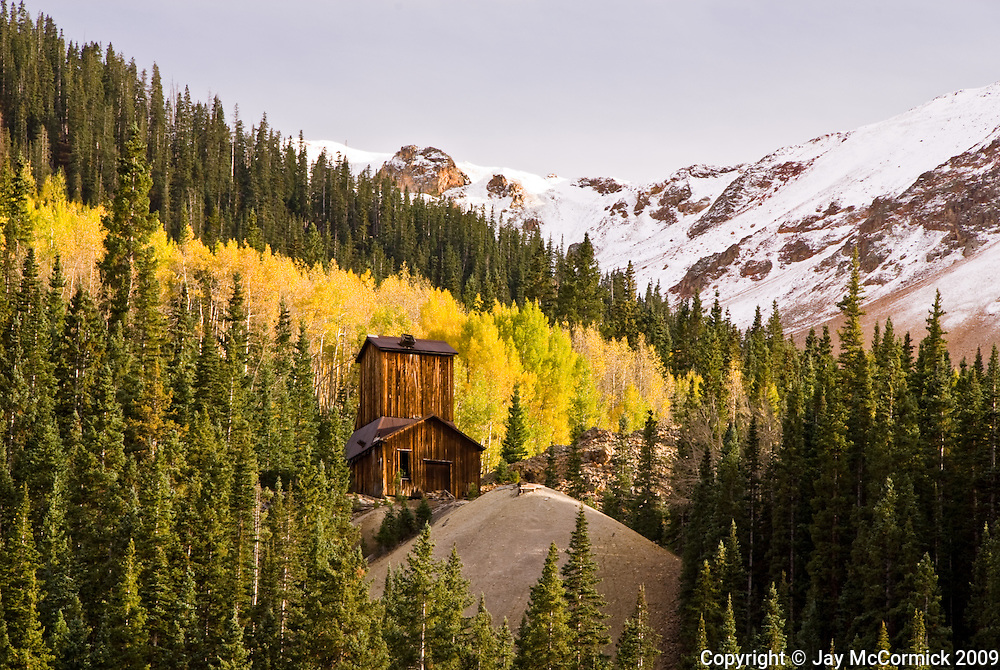 Old abandoned mine along the Million Dollar highway just north of Ouray, Colorado.  Shot during October. Very late color.
