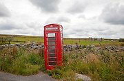 Red telephone box booth on moorland near Princetown, Dartmoor national park, Devon, England, UK