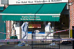 © London News Pictures. 19/11/2011. Police forensics enter Kingsbury Halal Butchers on Kingsbury Road, North West London the scene where four police officers where stabbed early this morning (19/11/2011). A man attacked the police officers with a knife he grabbed from the butchers shop after he had been chased by the police. Photo credit : Ben Cawthra/LNP