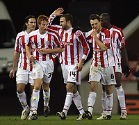 Photo: Paul Thomas.<br /> Stoke City v Millwall. The FA Cup. 05/01/2007.<br /> <br /> Danny Higginbotham (14) and Stoke celebrate his opening goal..