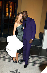 Fashion designer OZWALD BOATENG and his wife GYUNEL at a fashion show and after party to celebrate the 20th Anniversay of fashion designer Ozwald Boateng held at the Victoria & Albert Museum, London on 25th November 2005.<br />