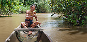 Mentawai indigenous man on boat (Indonesia).