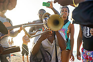 Trombone player during imrpomtu concert on the beach. <br /> Marazul, Havana, Cuba 2015