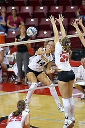 21 September 2007:  Kari Staehlin steps in to block a hit by Angela Jakubov, but the ball goes right. The Wichita State Shockers bested the the Illinois State Redbirds on the floor of Doug Collins Court in Redbird Arena on the campus of Illinois State University in Normal Illinois taking the match in three games.