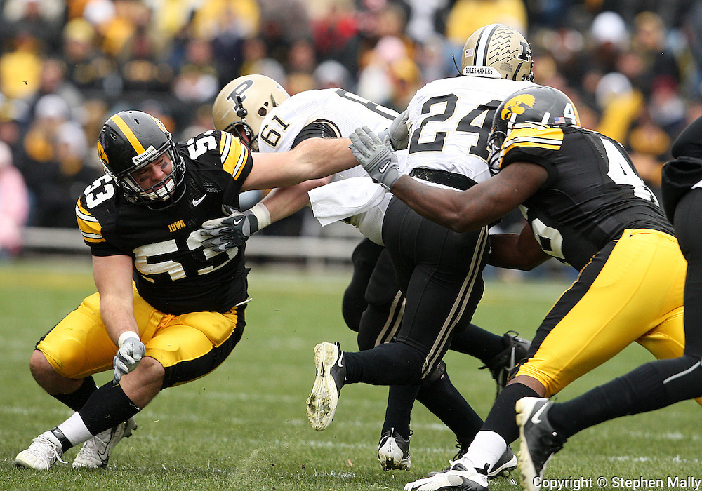 15 NOVEMBER 2008: Iowa defensive lineman Matt Kroul (53) tries to get a hand on Purdue running back Kory Sheets (24) in the first half of an NCAA college football game against Purdue, at Kinnick Stadium in Iowa City, Iowa on Saturday Nov. 15, 2008. Iowa beat Purdue 22-17.