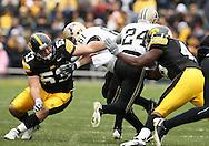 15 NOVEMBER 2008: Iowa defensive lineman Matt Kroul (53) tries to get a hand on Purdue running back Kory Sheets (24) in the first half of an NCAA college football game against Purdue, at Kinnick Stadium in Iowa City, Iowa on Saturday Nov. 15, 2008. Iowa beat Purdue 22-17.