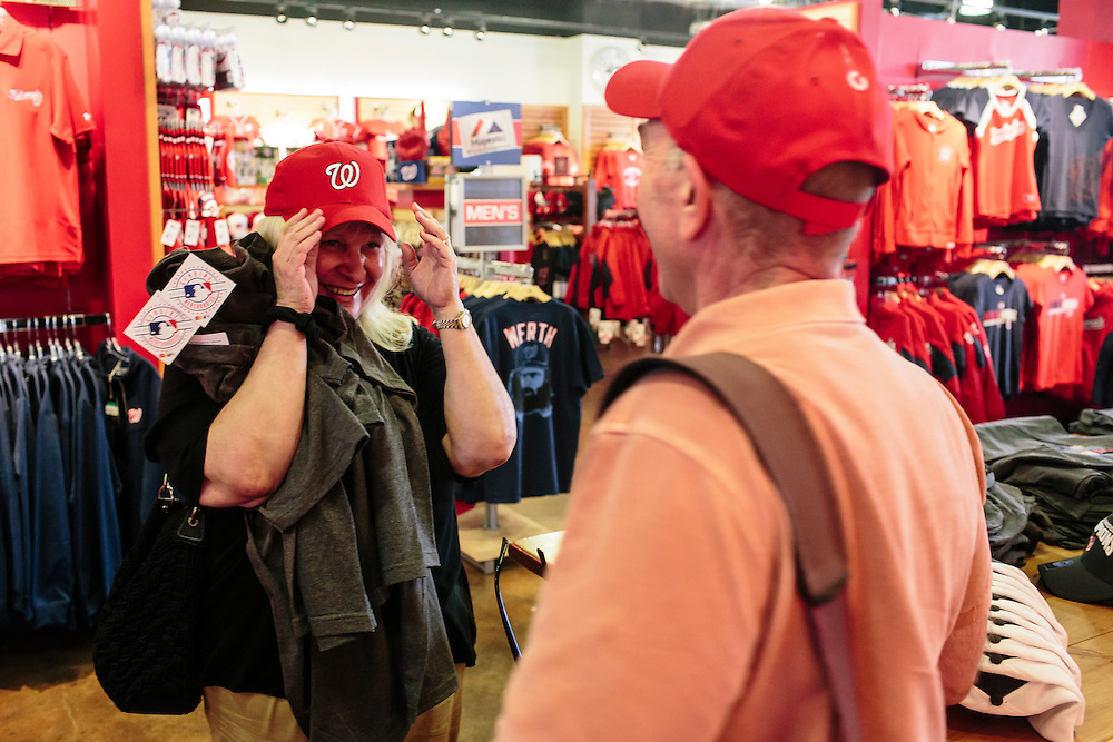 Shirlene Ceballos and Alex Belano try on hats at the Washington Nationals Clubhouse Team Store on Sept. 18, 2014. The co-workers bought Nationals division championship t-shirts for friends and family. The Nationals and Baltimore Orioles clinched the first two post season spots within hours of one another.