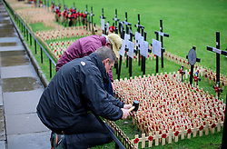 © Licensed to London News Pictures. 09/11/2016. London, UK. Crosses being placed in the field of remembrance at Westminster Abbey in London, ahead of it opening officially tomorrow (Thurs). The Field of Remembrance pays tribute to all  Service men and women who have served in our Armed Forces since World War I. Photo credit: Ben Cawthra/LNP