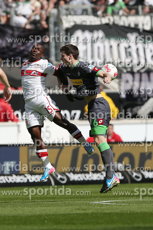 14.04.2013, Mercedes Benz Arena, Stuttgart, GER, 1. FBL, VfB Stuttgart vs Borussia Moenchengladbach, 29. Runde, im Bild Bild: Arthur BOKA (VfB Stuttgart), links im Kopfballzweikampf mit Havard NORDTVEIT (Borussia Moenchengladbach) // during the German Bundesliga 29th round match between VfB Stuttgart and Borussia Moenchengladbach at the Mercedes Benz Arena, Stuttgart, Germany on 2013/04/14. EXPA Pictures © 2013, PhotoCredit: EXPA/ Eibner/ Eckhard Eibner..***** ATTENTION - OUT OF GER *****