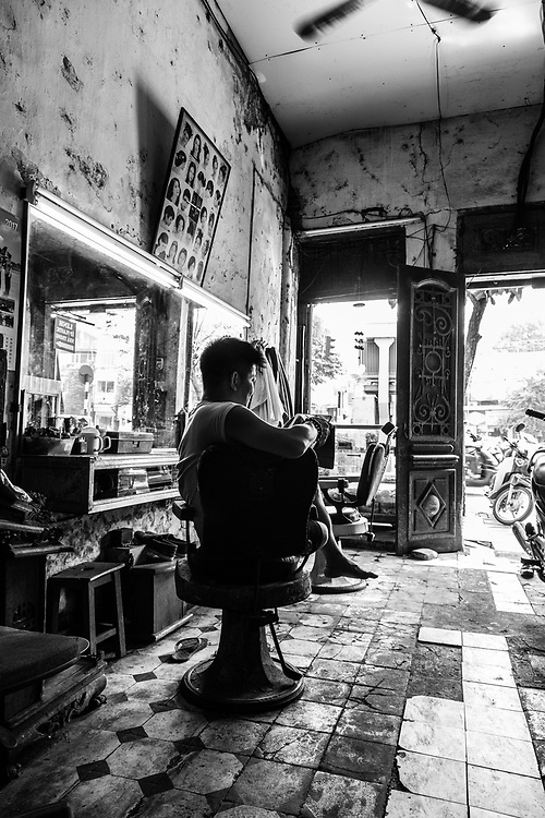 Where: Hanoi, Vietnam.<br /> Why? The city has an amazing history. This in fact is a family owned barbershop that has been family owned since 1945. Now run by the son.