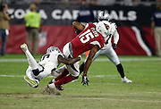 Arizona Cardinals wide receiver Michael Floyd (15) catches a pass while trying to avoid a diving tackle attempt by Oakland Raiders cornerback David Amerson (29) during the 2016 NFL preseason football game against the Oakland Raiders on Friday, Aug. 12, 2016 in Glendale, Ariz. The Raiders won the game 31-10. (©Paul Anthony Spinelli)