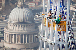 Client: Mace. Last steel structure being bolted onto the top of The Shard. Photo: Anthony Charlton