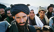 Afghans always study foreigners with an intense curiosity, but behind the piercing eyes lies the warmest of welcomes from these incredibly hospitable people. <br /> <br /> Western desert, near Herat, Afghanistan